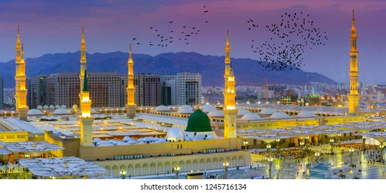 Masjid Nabi, Medina. The outer view of the minarets and the green dome of a mosque.