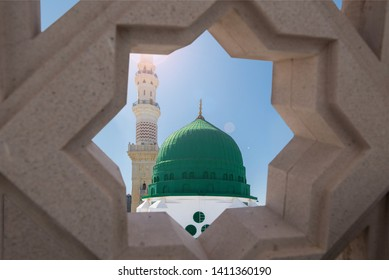 Masjid Nabi and minaret, Medina. The outer view of the minarets and the green dome of a mosque.  Medina, Saudi Arabia