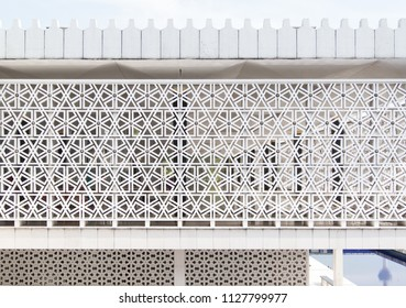 Masjid Negara, Kuala Lumpur. Beautiful facade of islamic mosque with structural, geometric pattern in white. Architectural modern gem, landmark in Malaysia creates a geometrical textured background