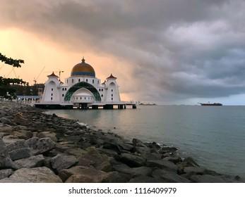 Masjid Selat Melaka or Malacca Straits Floating Mosque during cloudy sunrise