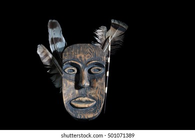 mask African leader made of wood, isolated on black background. free space for text
