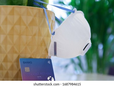 Mask and credit card on abstract background