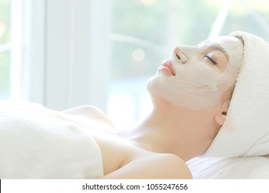 mask face spa, cheerful beautiful lady relax healthy therapy to renew close-up skin care with mud in room spa, content to facial treatment daily