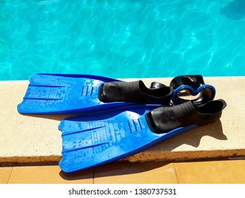 Mask and flippers in a swimming pool. Swim items (Masks and fins)Sports accessories for swimming. Underwater masks and flippers