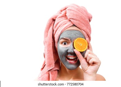 mask for skin woman, happy and funny girl makes mask for face skin, girl closes her eyes with orange, isolated photo, emotional gender role