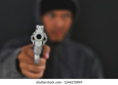 Masked Armed robbers pointing a handgun to robbery the money, Uses Gun in Armed Robbery, Gun Point , used for the illustration or montage of your design, Banner for advertise of product