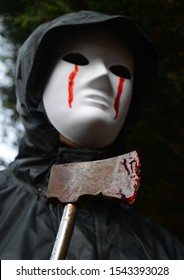 Masked attacker with a blood stained axe