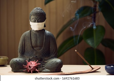 Masked Buddha contemplates covid-19 virus