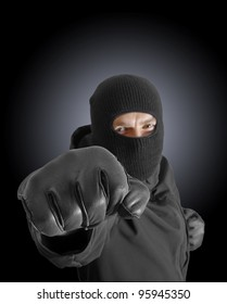 Masked criminal with clenched fist