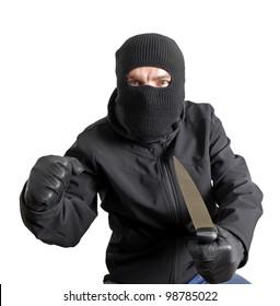 Masked criminal holding a knife, isolated on white