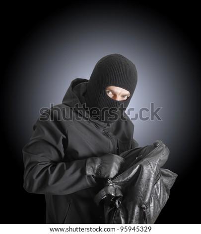 Masked Criminal Holding Stolen Handbag Stock Photo (Edit Now