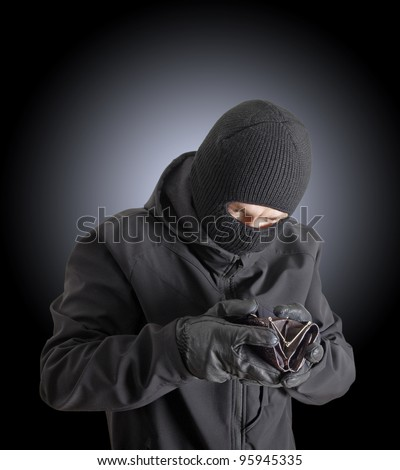 Masked Criminal Holding Stolen Leather Purse Stock Photo