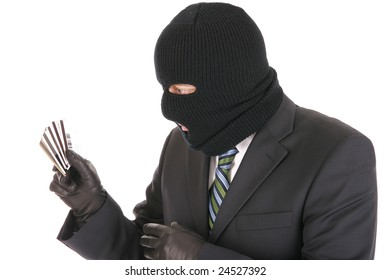 Masked criminal stealing credit cards - isolated over the white background