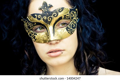 Masked curly woman, closed view