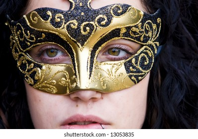 Masked curly woman, very close view