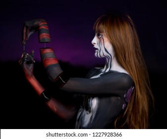 masked girl made up for halloween horror and photomanipulation