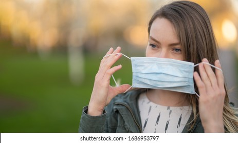 Masked girl on an empty street in the USA. Coronavirus. Pandemic epidemic. Outbreak of illness. Media and news publishers, ban on traveling in public places.