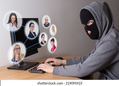 masked hacker stealing data from computers
