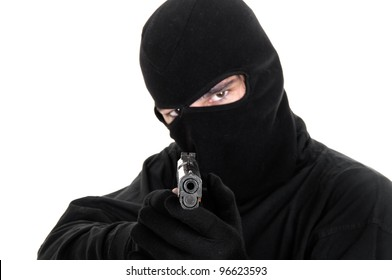 Masked man aims with gun , selective focus