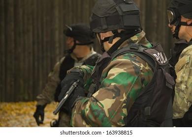 A masked man with a gun