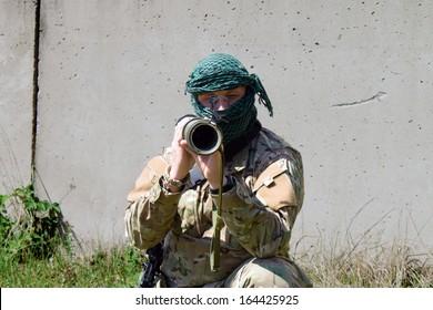 A masked man with a gun, a terrorist