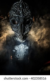 The masked man in the iron alien. Voodoo.