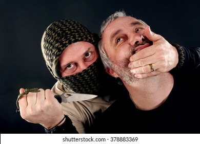 a masked man with a knife attacked another man