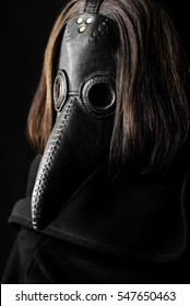 a masked man plague doctor