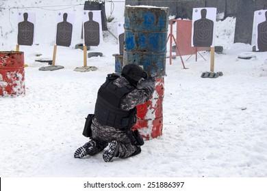 A masked man at the shooting range
