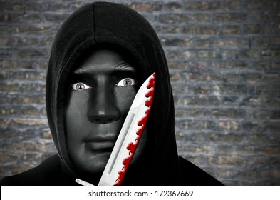 Masked murderer with knife and hooded sweat shirt