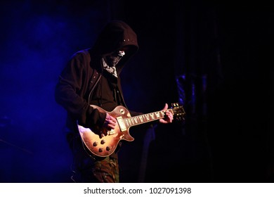 the masked musician with a guitar