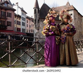 Masked people during Annecy carnival