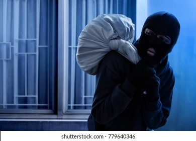Masked thief escaping