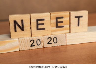 Maski, India 26,May 2019 : NEET or National Eligibility and Entrance Test RESULTS 2020 in wooden block letters.