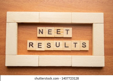 Maski, India 26,May 2019 : NEET or National Eligibility and Entrance Test RESULTS in wooden block letters