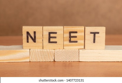 Maski, India 26,May 2019 : NEET or National Eligibility and Entrance Test RESULTS in wooden block letters.