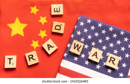 Maski, India 29,May 2019 : China-US trade war concept - flag of China and the United States with wooden block letters.