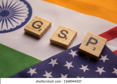Maski,India 13,April 2019 : Alphabet letter in word GSP Abbreviation of Good Storage Practice or Generalized System of Preferences or Gross State Product on Indian and American flag