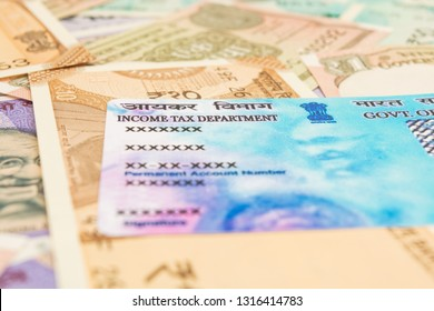 Maski,Karnataka,India - FEB,12,2019 : Closeup of PAN card with Indian currency