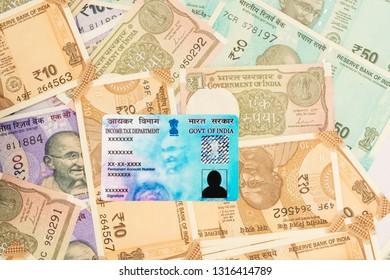 Maski,Karnataka,India - FEB,12,2019 : PAN card on stack of Indian new currency notes