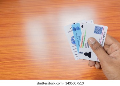 Maski,Karnataka,India -June 26 ,2019: Holding Aadhaar card, Ration card and voter ID which is issued by Government of India as an identity card