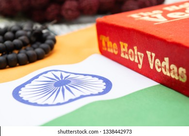 Maski,Karnataka,India - March 13,2019 :The Holy Vedas on wooden textured background with Indian flag