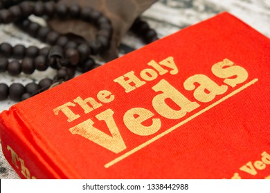Maski,Karnataka,India - March 13,2019 :The Holy Vedas on wooden texture as a background.