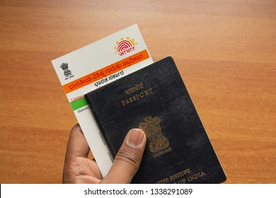 Maski,Karnataka,India - March 14,2019:Holding Aadhaar card and passport which is issued by Government of India as an identity card to travel foreign