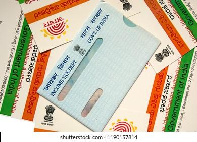 Maski,Karnataka,India -SEPTEMBER 27,2018: Scattered Aadhaar card and pan card on table