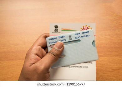 Maski,Karnataka,India -SEPTEMBER 27,2018:Holding Aadhar card and pan card  which is issued by Government of India as an identity card,