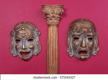 Masks of the Greek theater, representing joy and sadness, between a column of the same style