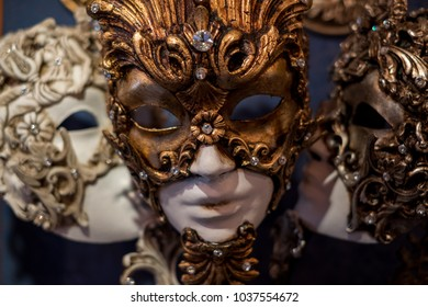 Masks hanging on wall in a mask shop, Venice, during the Venice Carnival (Carnivale di Venezia) 2018.