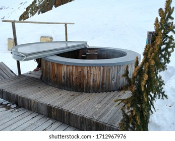 Maso Corto, Italy - 02 07 2019: The hot water open pool of the Rifugio Bellavista (Schone Aussicht in German), the hut on top of Val Senales which is a ski resort in winter and includes a spa