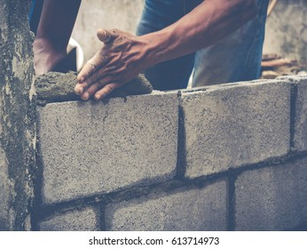 Mason or Brick builders are building walls in Thailand